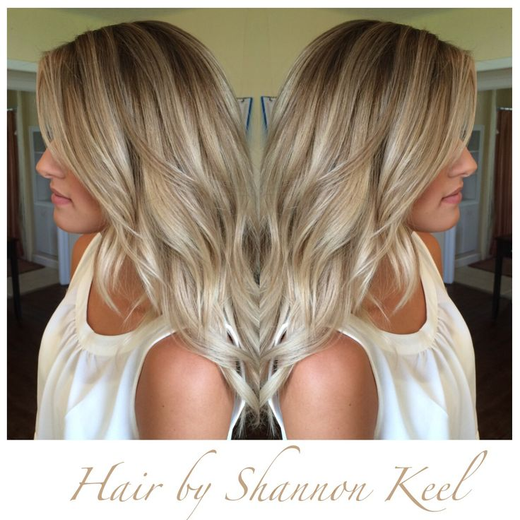 Beautiful Beige sombre hair. This look is between an ombré and balayage look. By