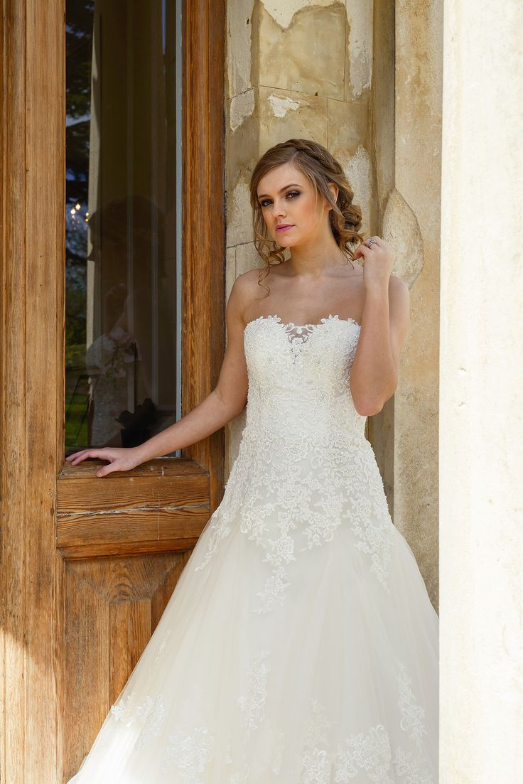 Beautiful  Parry a stunning drop waist bridal gown with a sparkly beaded bodice soft tulle skirt and an AMAZING train Our sample is in a beautiful rum pink but