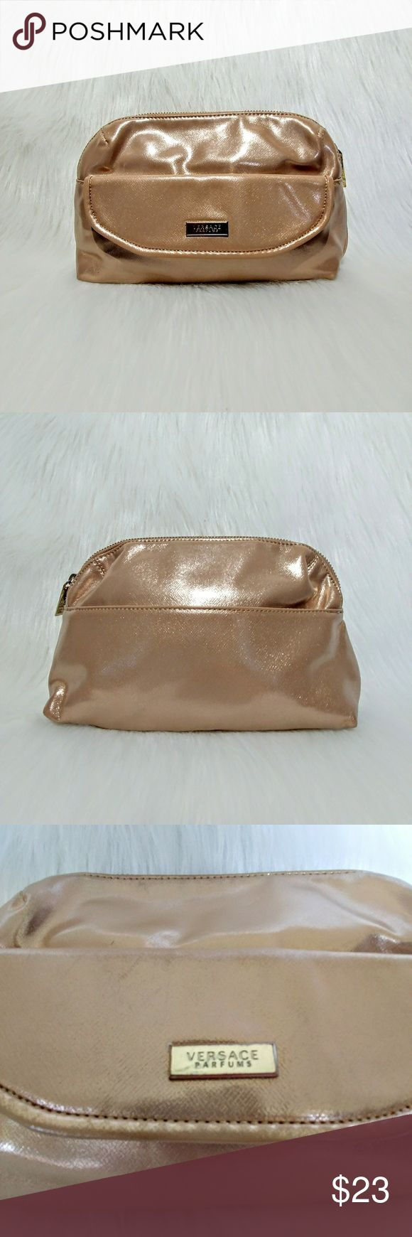 """Versace Bag/Clutch Versace Parfume bag in rose gold. This zip closure bag measures 10.5"""" x 7"""" and can be used as a cosmetic bag or clutch. Lots of space including a front button closure pocket & an additional exterior pocket on the back. Interior lining is in perfect condition, zippers have a few small scratches. Versace Bags"""