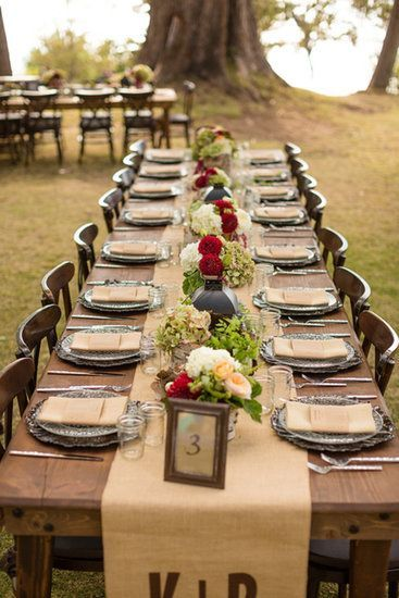 Gorgeous outdoor reception tablescape with a monogrammed burlap table runner
