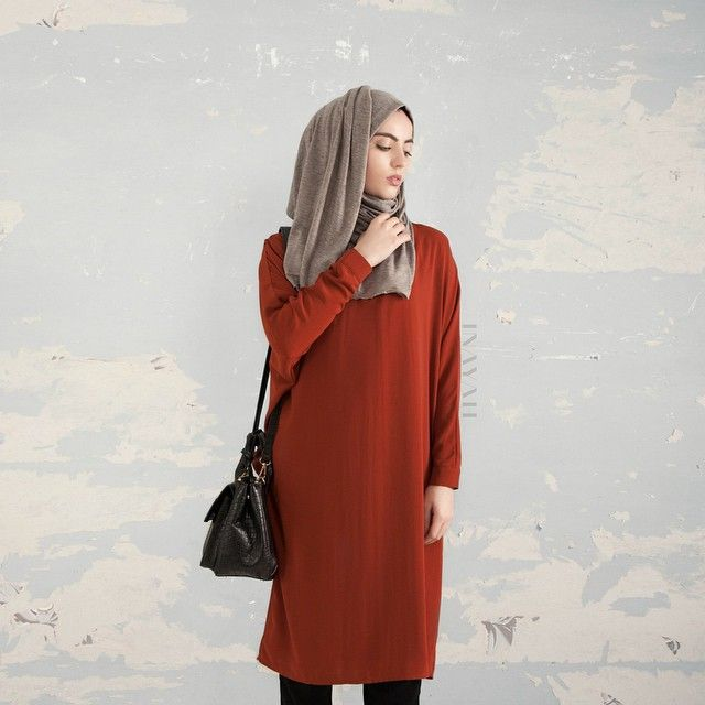 - A modern inspired look, offering an effortless and versatile outfit choice. Compliment the rustic hue with neutral colours for a relaxed ensemble.  Feather Grey Knitted Hijab  Rust Batwing Midi Dress  www.inayahcollection.com