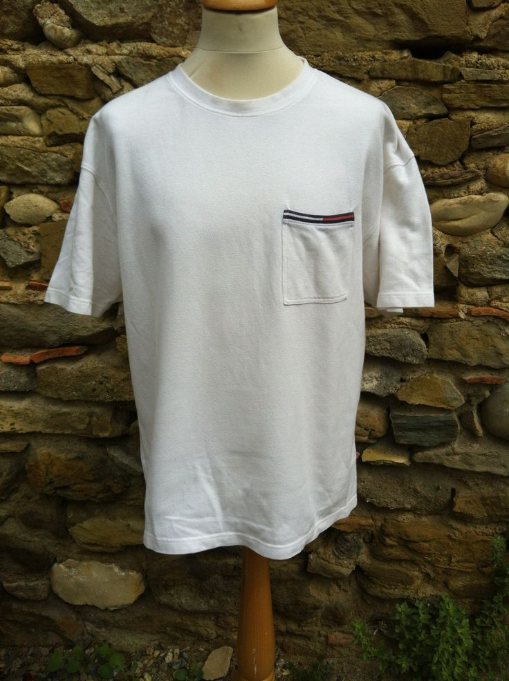 Check this sweet white cord threaded Tommy Hilfiger Top with a branded top Pocket. Decent weight to thread No rips, tears or discolouring. Some fade to the pock