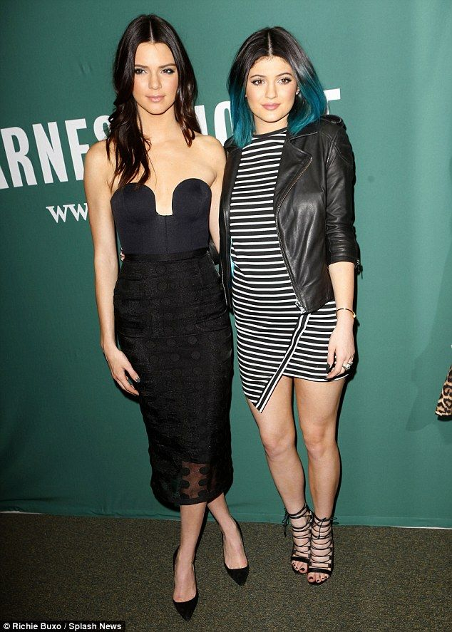 Racy streak: Kendall Jenner wore a daring bustier top and high-waisted skirt as she and sister Kylie and gal pal  promoted their new sci-fi book in NYC on Wednesday