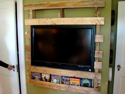 Turn a pallet into a Wall Mount for a TV and storage for movies, remotes, etc. Such a cool idea!
