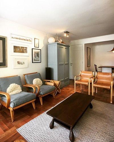 Modolo cabezon arquitectos living sitiales cuero valdez celestee mueble bar piso parquet alfombra