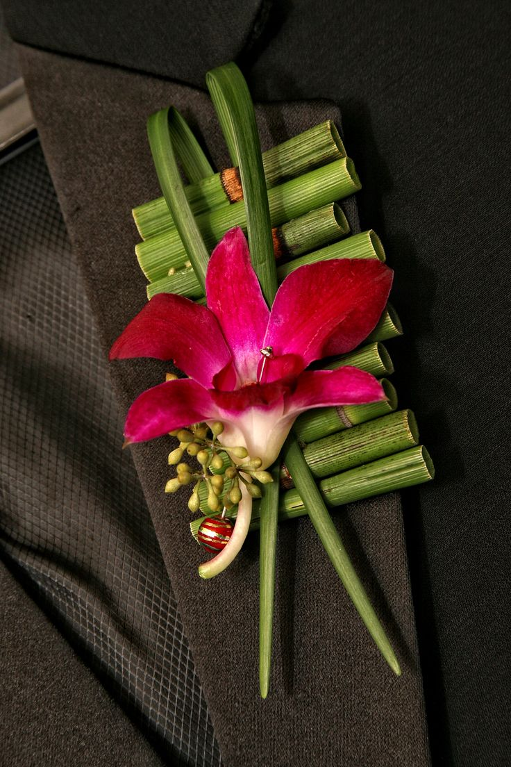Orchid and equisetum boutonniere designed by Lana with Fairbanks Florist, Photo by Art Faulkner