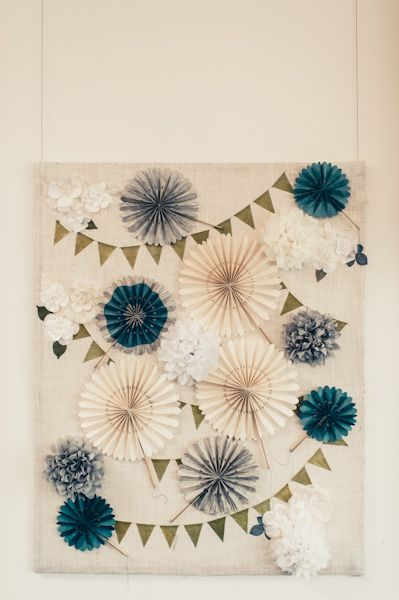 Paper medallion backdrop - I have tons of tissue paper I picked up at my parent's house, so we could do a combination of the bunting and paper pleated things and flowers - what do you think?