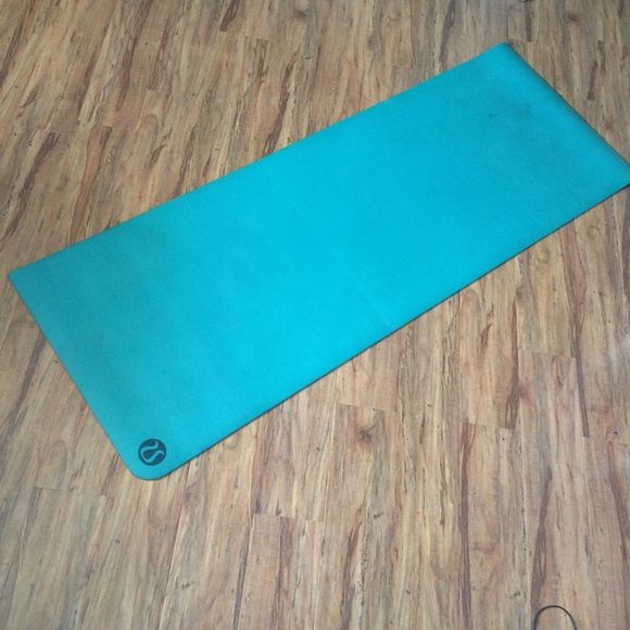 Aqua turquoise Lululemon yoga mat Super amazing Lululemon yoga mat. I'm out of yoga mat spray and so I don't have anything to clean the scuffs with.. So I'm selling this super low. This mat also works great with a towel. Enjoy yogis! lululemon athletica Other