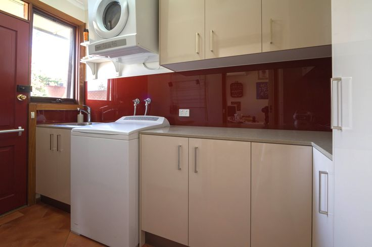 Contemporary kitchen and laundry loaded with practical storage solutions. www.thekitchendesigncentre.com.au @thekitchen_designcentre