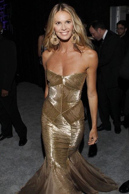 Elle Macpherson changed from her Zac Posen red carpet gown to a strapless gold number for the after-party circuit.