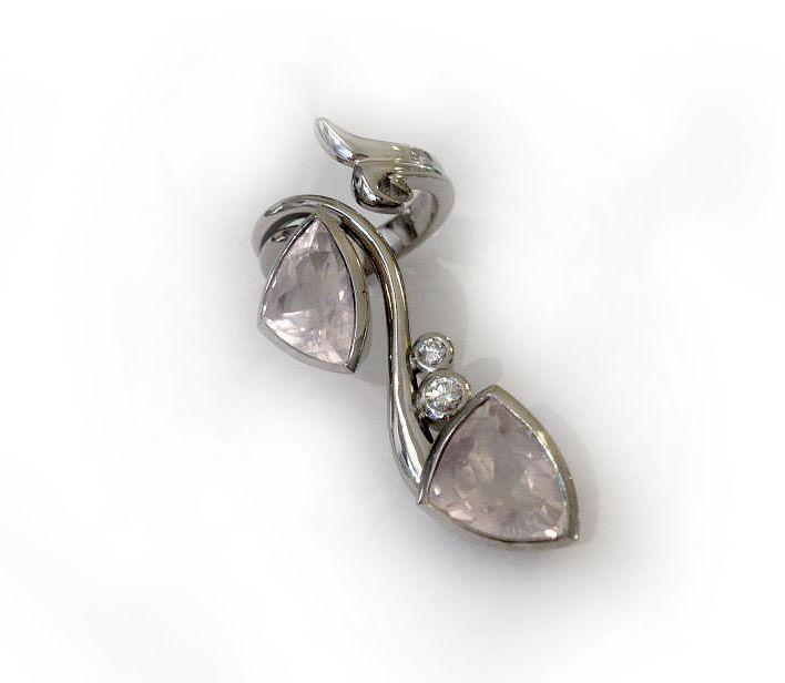 Unique white gold ring with diamonds and rose quartzs.
