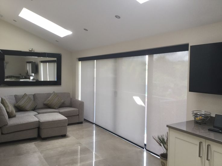 White Roller blinds in living room fitted by us | Bolton Blinds Testimonial | Bolton Blinds
