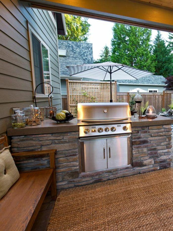 espace barbecue et cuisine d'extérieur en pierre naturelle