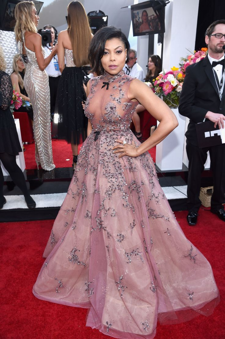 SLAY! Taraji P. Henson was the definition of 'fierce' in this see-through gown that showed so much boob! (Photo by Dimitrios Kambouris/Getty Images for TNT)  via @AOL_Lifestyle Read more: https://www.aol.com/article/entertainment/2017/01/29/sag-awards-2017-red-carpet-arrivals/21702677/?a_dgi=aolshare_pinterest#fullscreen