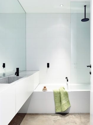 The service spaces, such as the bathrooms, are sandwiched between the living areas and bedrooms.
