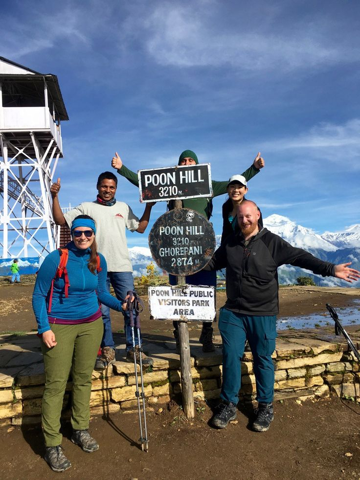 Trekking to Poon Hill on the way to Annapurna Base Camp in Nepal with our Nepali guide. You don't NEED a guide in Nepal, but trust me you WANT one. Click through to read my reasons why.