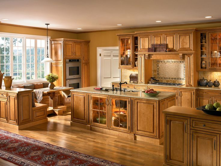 The raised panel cabinet doors and oil rubbed bronze hardware give this  kitchen a refined grace