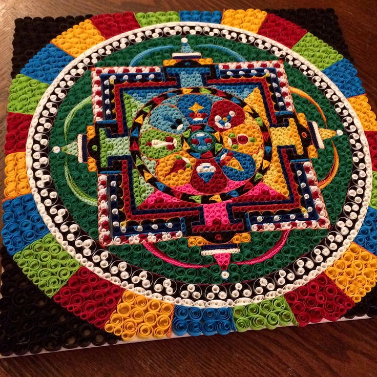 A personal favorite from my Etsy shop https://www.etsy.com/listing/272274838/quilled-tibetan-sand-mandala-wall-art