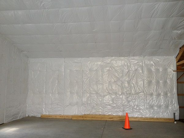 Pole Building Insulation installed in Walls with Washers and Screws. This Installation Method gives the Interior a Clean Finished Look. Call 1-800-486-8415 for Pole Building Insulation Materials or visit: http://polebuildinginsulation.com/