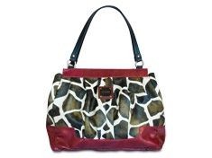I have this bag & LOVE IT!! BUT I put the knotted red handles on it! So stinkin' cute! I <3 Miche Bags!