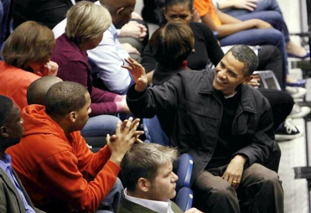 Bam attends a college basketball game between George Washington University and Oregon State. Michelle Obama's brother, Craig Robinson, is head coach of Oregon State.
