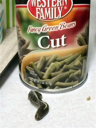 This Wednesday, Feb. 17, 2016 photo shows a snake head that Troy Walker, of Farmington, Utah, says she found in a can of green beans. Walker said she made the unsettling discovery while she and fellow church members were preparing meals Wednesday night for neighbors. Walker said she took the snake head and empty can back to the grocery store where she bought the food. She took a picture first of the snake head to send to Western Family, a food distribution company based in Oregon, which has…