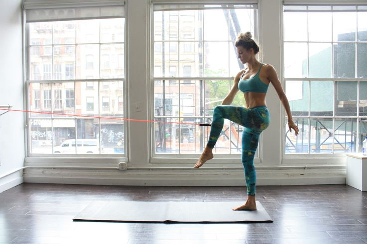 Try this ModelFit workout at home to sculpt a long, lean figure. The buzzy fitness studio counts fans like Karlie Kloss, Taylor Swift, and Lily Aldrdige.
