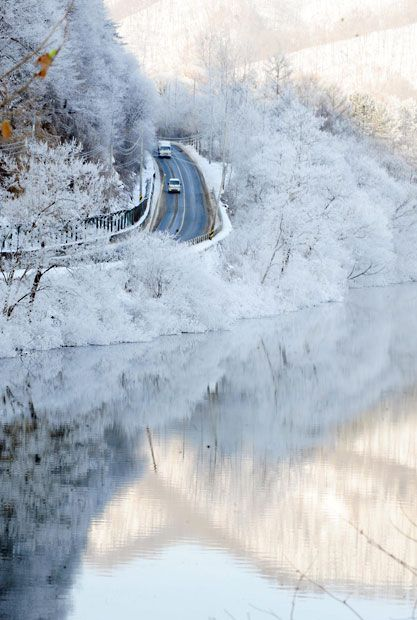 The area around Chuncheon Lake in South Korea is transformed into a winter wonderland during a severe cold snap