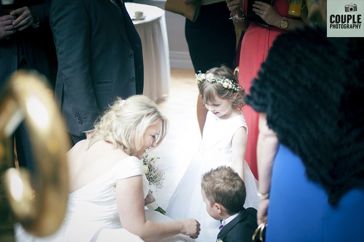 The bride takes a moment with her flower girl & page boy. Weddings in Mayo, Photographed by Couple Photography.