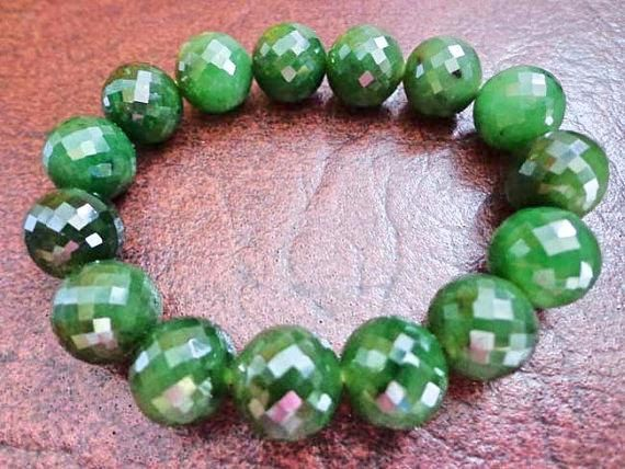 12 mm Nephrite jade faceted round bead bracelet. S443
