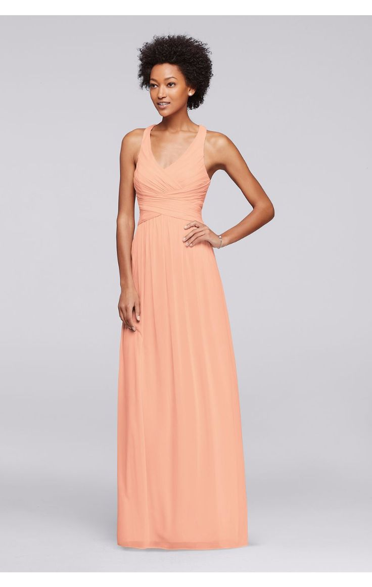 Cute This long mesh bridesmaid dress is a flattering option thanks to the fitted bodice V neckline and crisscross back straps fully lined Dry clean Imported