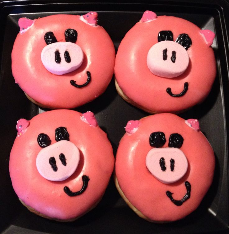 A friend of ours was accepted into the police academy, and I figured what better way to celebrate than with Pig donuts!  These pretty and pink treats were super easy.  I ordered pink glazed donuts from the bakery, cut a couple large pink marshmallows in half for the nosed, cut up a couple square cookies for the ears and used black frosting to draw on the rest!