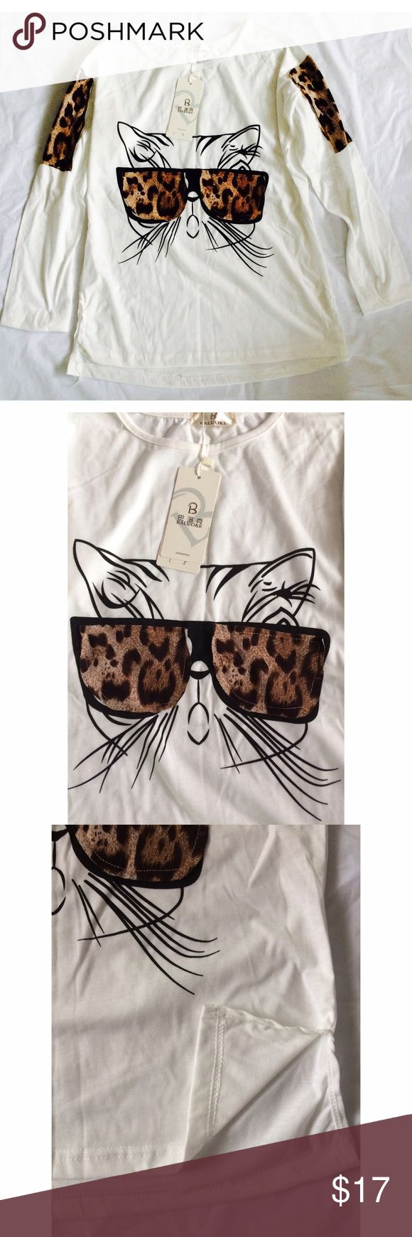 Cute Leopard Print Kitty Top NWT Longer than 3/4 Sleeve. Cute Leopard Print Top, slightly sheer not very, sides have small slits.  Medium/Small depending if your chest is bigger. Korean Tops Tees - Short Sleeve
