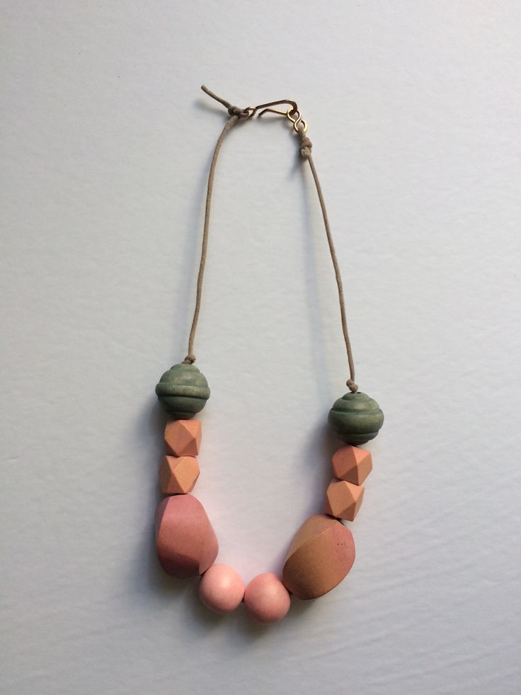 The Angela Necklace is a soft mix between pink and green providing a calm and serene look for mom.