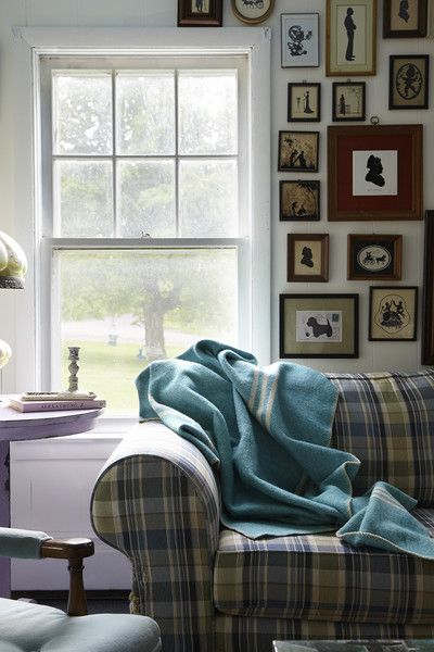 Eclectic Traditional Decor: Art filled wall hanging over plaid couch