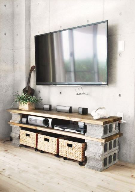 If we found some nice cheap timber boards we make a low single brick high tv unit. Cinder bricks are like $3 each
