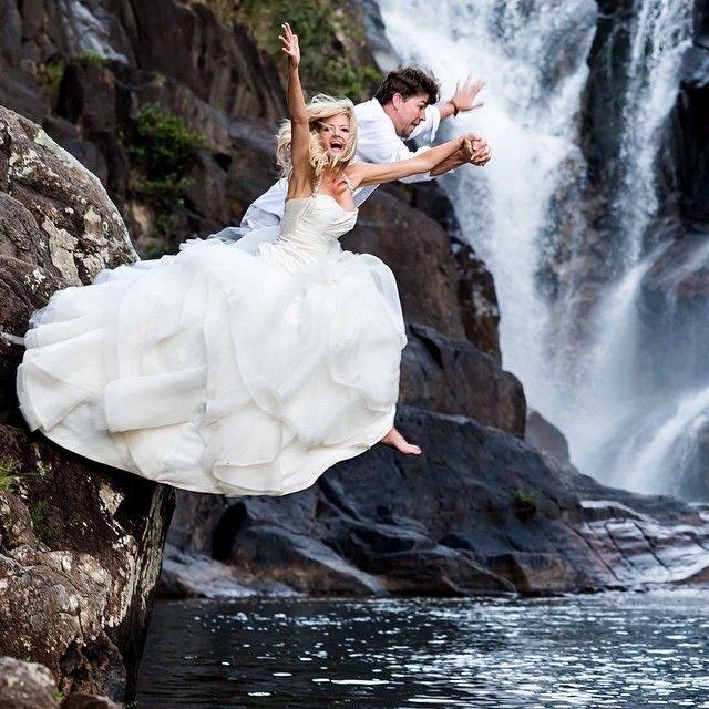Annie and Patrick could have been on a business trip but instead, they were jumping off waterfalls in Belize. #workhardplayharder #trashthedress #belizeweddings #waterfallwedding #belize #weddings
