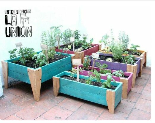 Colorful planter boxes with fancy legs. :-) Too adorable.