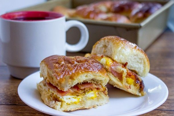 Baked bacon, egg, and cheese sandwiches on hawaiian rolls! You can add veggies, too.
