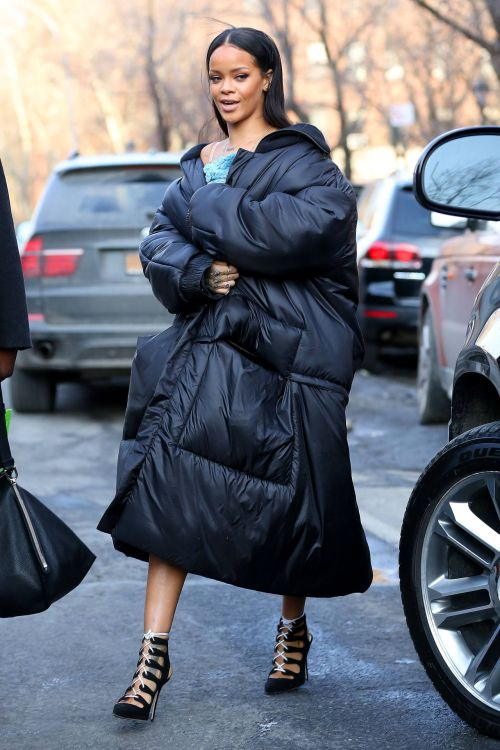 Rihanna in a huge and awesome quilted coat