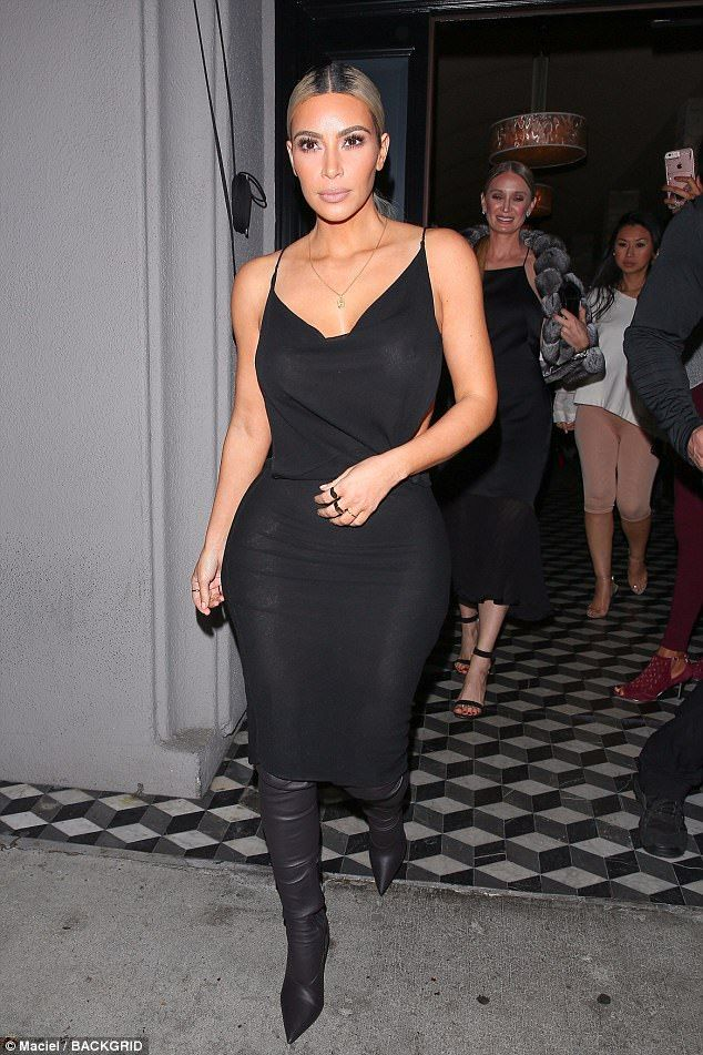 Eye catching: Kim Kardashian was spotted back in Los Angeles as she headed to dinner at Craig's on Friday; seen with Marina Acton and close friend Tracy Romulus