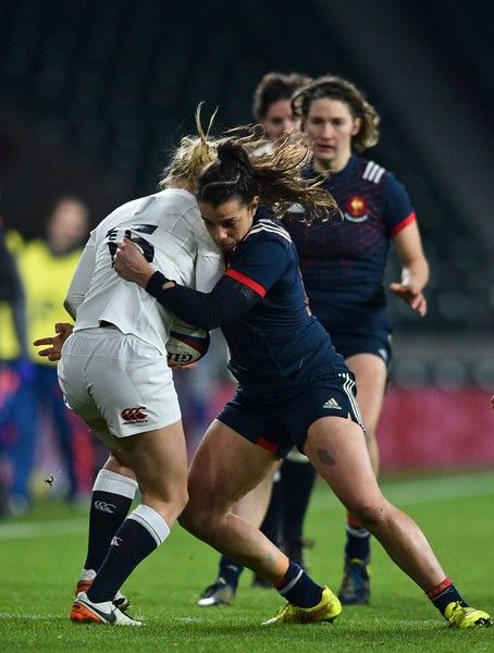 England's full-back Danielle Waterman (L) is tackled by France's wing Elodie Guiglion during the Six Nations international women's rugby union match between England Women and France Women at Twickenham stadium in south west London on February 4, 2017. / AFP / Glyn KIRK
