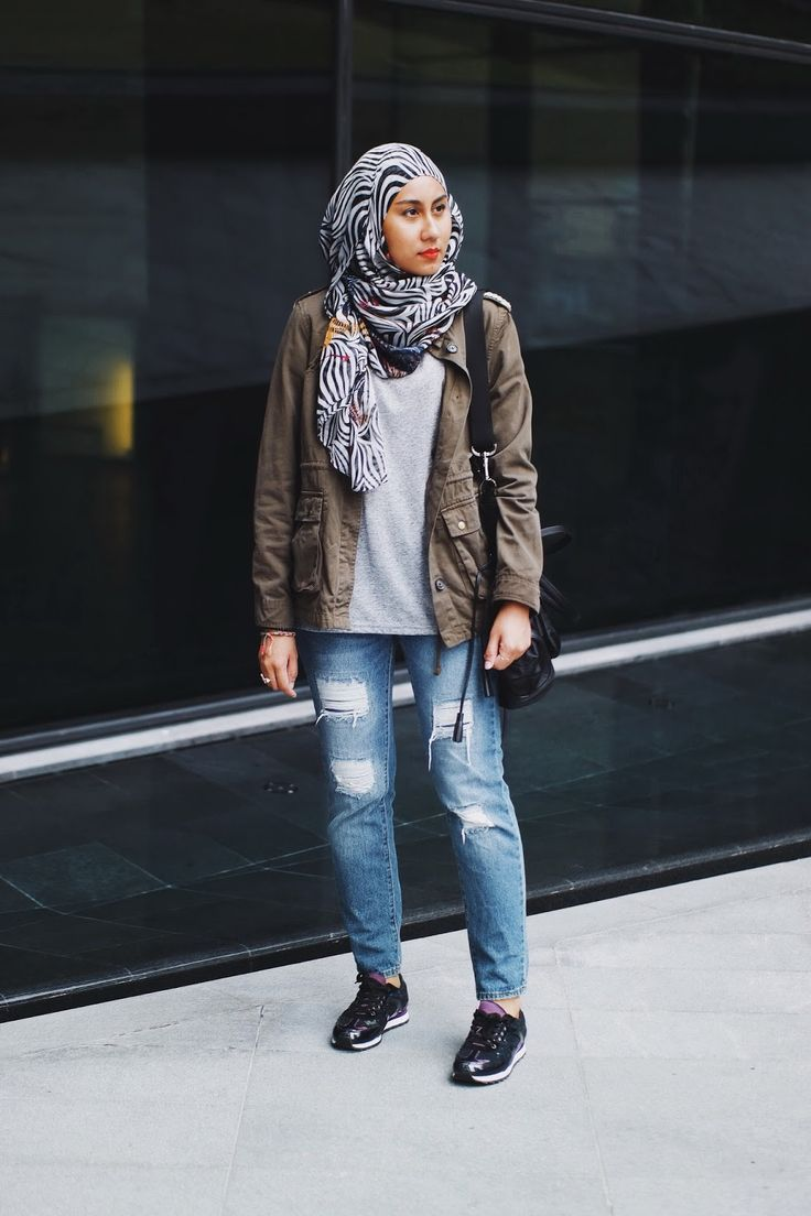 Utilitarian jacket, ripped jeans, sequinned sneakers, zebra print scarf