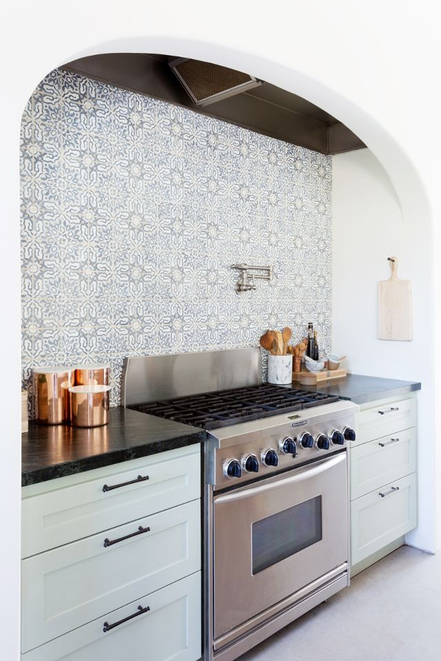pale kitchen cabinets & patterned tiled wall