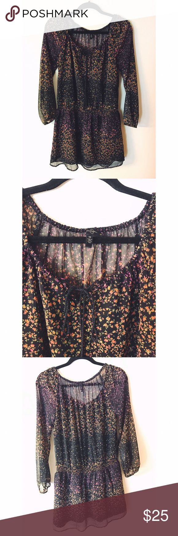 Long sleeve floral Jessica Simpson dress {If the perfect peasant top suddenly became a dress...} This black number is a boho beauty with details like a keyhole cutout in the front, cinched waist, floral pattern, slouchy sleeves, and see-through back (but only on the top!) Jessica Simpson Dresses Long Sleeve
