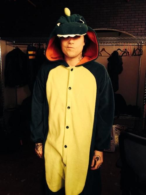 """Frank Iero in his amazing dragon onesie!"" - Twitter from shitdeweessays. They're on set to shoot a music video for ""37"" off Reggie and The Full Effect's newest album ""No Country for Old Musicians""."