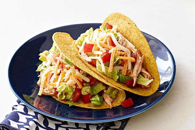 Made with tender, juicy chicken that simmered all day in a slow cooker, these tacos may well be the best you've ever tasted.