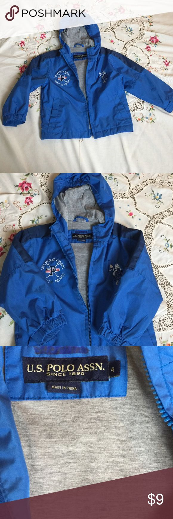 Raincoat, Boys, US Polo Association, Size 4 Nice blue raincoat! This lasted two seasons in our house but not worn often since we are in Southern California! Only mark is on the tag where I crossed my son's name out. No other tears or stains. There is a very cool hidden pocket in the lining. ☺️ U.S. Polo Assn. Jackets & Coats Raincoats