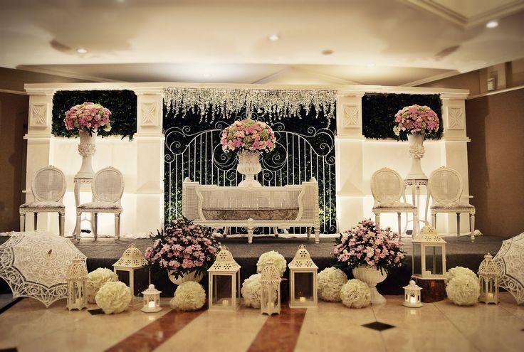 Pelaminan (Bridal Stage) with green leaves wall, white furniture & vintage white garden iron fence