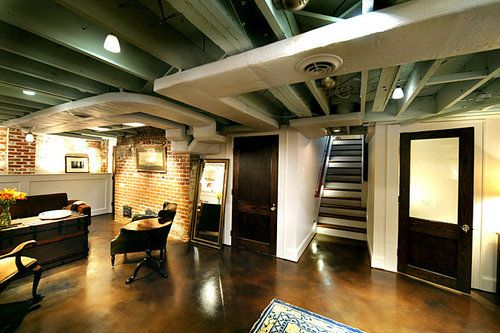 The finished basement with its concrete floors and exposed brick walls resembles a loft.